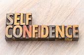 self confidence word abstract in vintage letterpress wood type printing blocks poster