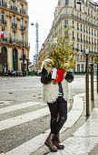 Trendy Child In Paris, France Hiding Behind Christmas Tree poster
