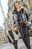 Modern Mother And Daughter In Paris, France Going Forward poster