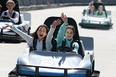 Two Happy Girls On Go Cart
