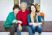 Happy Chinese Senior Adult Mother and Father with Young Adult Daughter Portrait poster