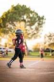 Girl playing softball or baseball poster