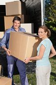 image of moving van  - Smiling couple moving boxes at their new home - JPG
