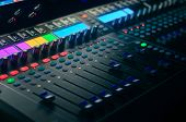 Board Mixing Console. Mixer. The Sound Engineers Console. Sound Engineers Fingers Are Pressing The poster
