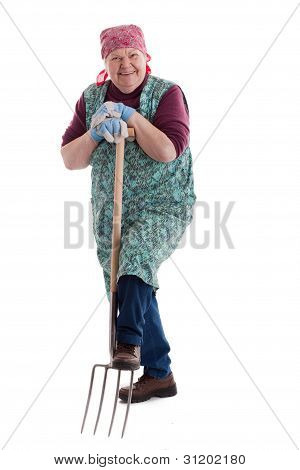 Active Elderly Woman Holding Pitchfork