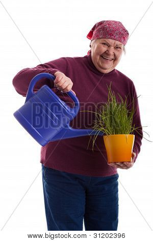 Friendly Senior Holding A Watering Can