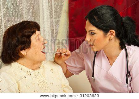 Doctor Examine Elderly For Sore Throat