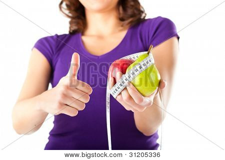 Healthy eating - woman with apple and pear and measuring tape dieting