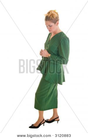 Concerned Business Woman With Hands Clasped