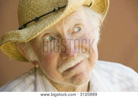Senior Citizen Man Smiling In A Straw Cowboy Hat
