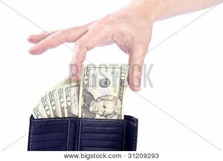 Man Pulling a $20 US Bill out of a Black Wallet