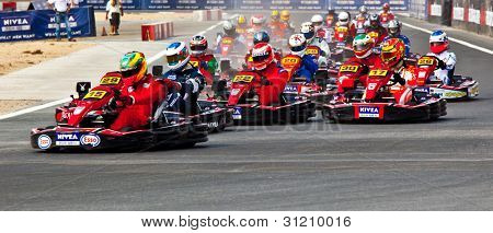 DUBAI, UAE - OCTOBER 23: Large group of kart racers begins the international racing competition on October 23, 2009 in Dubai Autodrome, United Arab Emirates