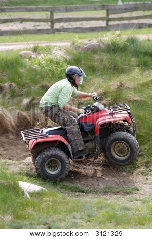 Man Riding A 4 Wheeler