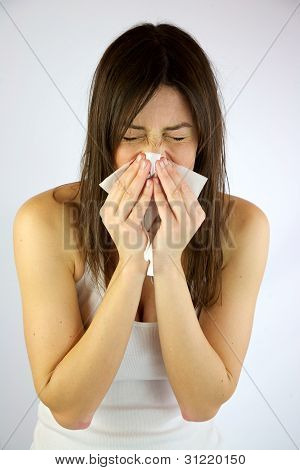 Female model sneezes strong