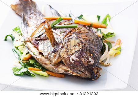 Tilapia fried with asian vegetables
