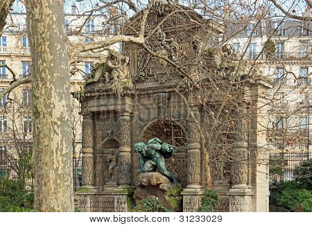 Medici fountain through the trees