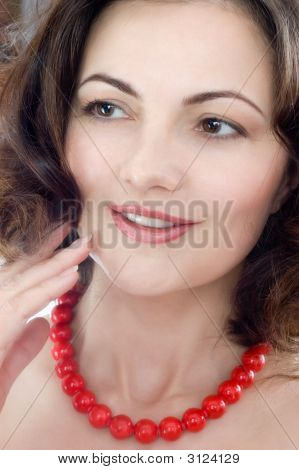 Beautiful Woman Wearing Red Coral Beads