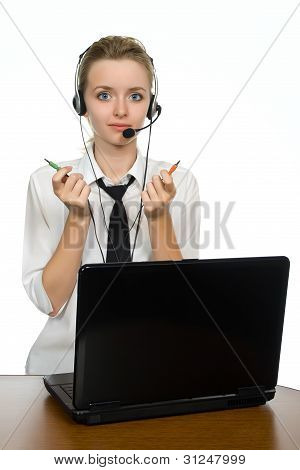 Young Blond Girl With Headphones Is Working On Laptop.