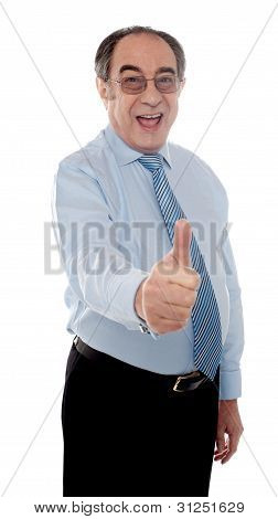 Happy Senior Manager Posing With Thumbs-up Gesture