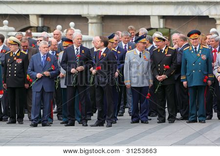 MOSCOW - MAY 8: State Duma deputies and veterans before ceremony of wreath laying at tomb of Unknown Soldier at Victory Day celebrations, on May 8, 2011, Moscow, Russia.