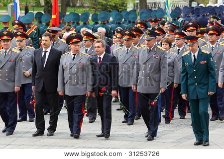 MOSCOW - MAY 8: Veterans, officers and State Duma deputies go at ceremony of wreath laying at tomb of Unknown Soldier at Victory Day celebrations, on May 8, 2011, Moscow, Russia.