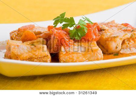 Fish and cherry tomatoes.