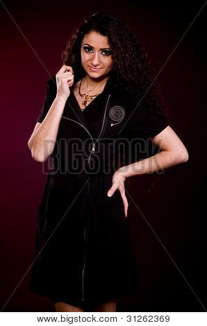 Portrait of the beautiful nice woman with long ringlets hair