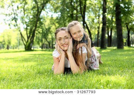 Mother with her daughter outside