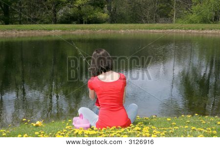 Woman Fishing By The Pond