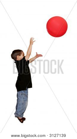 Boy Throwing Red Ball Over White