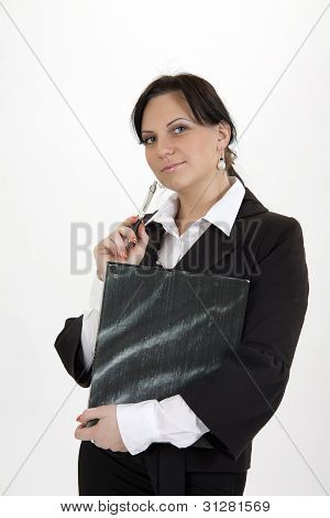 Business Woman Standing With Folder And Pen.