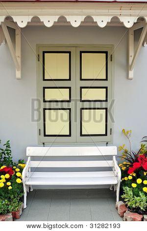 White Chair Against Window