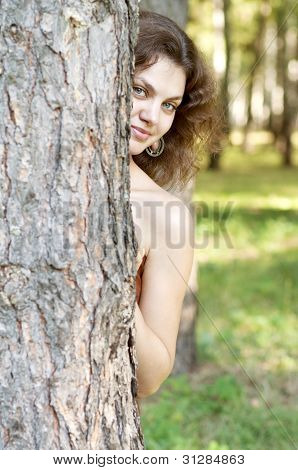 Beautiful woman near the tree