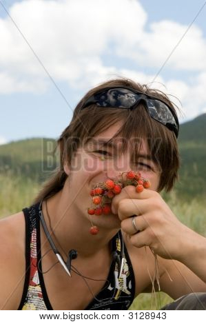 Boy Teens Wits Strawberries In Summer
