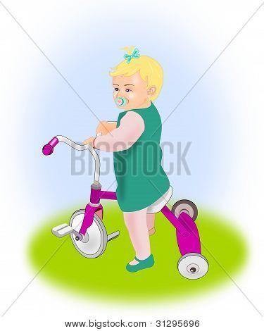 Niña en el triciclo.