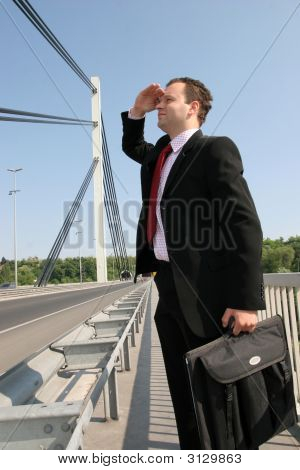 Businessman On Bridge