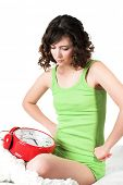 picture of underthings  - Portrait of young woman with alarm clock - JPG