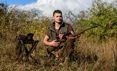 Recharge Rifle Concept. Man With Rifle Hunting Equipment Nature Background. Hunting Equipment And Sa poster