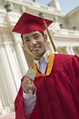 pic of early 20s  - Graduate Holding Medal - JPG