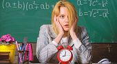 Time Management. Teacher With Alarm Clock At Blackboard. Time. Study And Education. Modern School. K poster