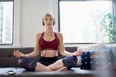Trendy Woman Listening To A Meditation App As Part Of Her Mindfulness Morning Routine poster