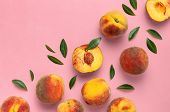 Flat Lay Composition With Peaches. Ripe Juicy Peaches With Green Leaves On Pink Background. Flat Lay poster