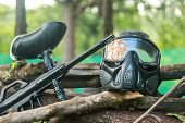 Paintball Mask Set And Gun. Paintball Mask Hit In Glasses After Play. A Paintball Gun And A Mask Pla poster