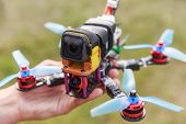 A Fpv High-speed Racing Drone Copter Lying On A Hand poster