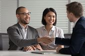 Happy Mixed Ethnicity Couple Make Mortgage Deal Handshake Bank Manager poster