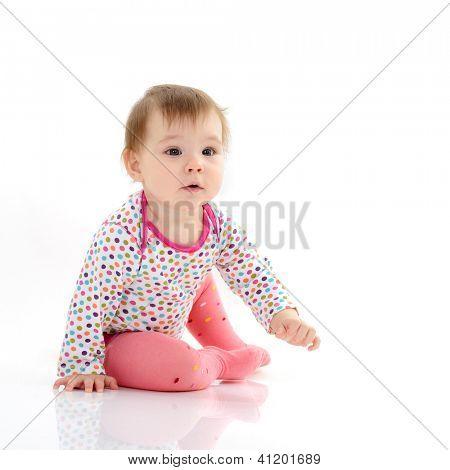 full length portrait of cute happy smiling sitting  little girl toddler, 10 month, studio over white