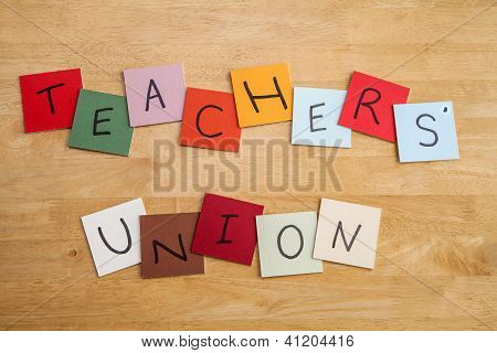 Teachers' Union Written On Square Color Tiles In Capital Letters.