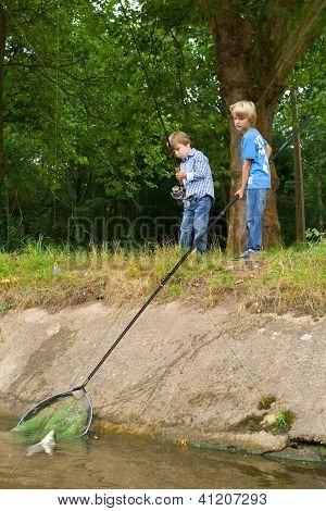 Boys Catching Big Fish