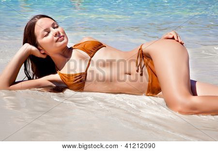 Happy woman relaxing in the water in a sea