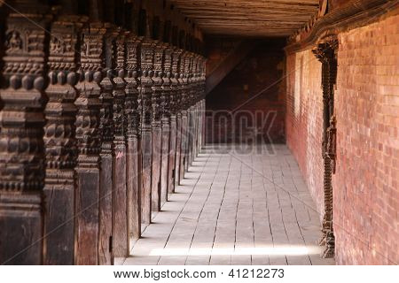 Wooden Pillars In An Old City